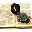 Compass and old book — Stock Photo