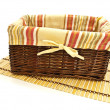 Foto Stock: Basket at bamboo mat