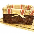 Basket at bamboo mat — Stock Photo