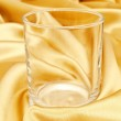 Single glass at golden background — Stock Photo