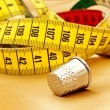 Measuring tape and thimble — Stockfoto