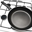 Frying pan at gas stove - Stock Photo