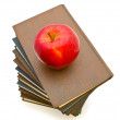 Stock Photo: Apple near books