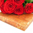 Roses and gift - Stock Photo