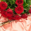 Roses and dagger — Stock Photo
