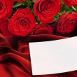 Roses with greeting card - Stock Photo