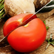 Cutting tomato - Stock Photo