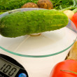 Cucumber on the scales - Stock Photo