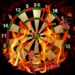 Darts in flame - Stock Photo