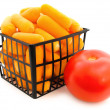 Carrot in basket and tomato — Stock Photo