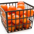 Small tomatoes in the basket — Stock Photo
