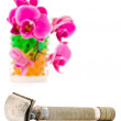 Orchid in glass and shave razor — Stock Photo