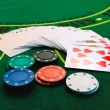 Cards and chips in casino — Stock Photo