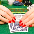 Woman hands with playing cards - Stock Photo
