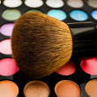 Stock Photo: Eye shadows with brush