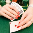Woman playing in casino — Stock Photo #1499966