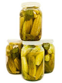 Glass jars with marinated cucumbers — Stock Photo