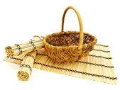 Basket and bamboo mats — Stock Photo