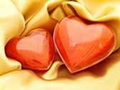 Red hearts at gold — Stock Photo