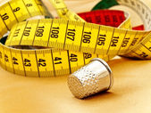 Measuring tape and thimble — Stock Photo
