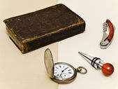 Old book and pocket watch — Stock Photo