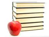 Apple near the books — Stock Photo