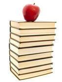Apple on the books — Stock Photo
