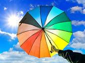 Umbrella in hand — Stock Photo