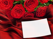 Roses with greeting card — Stock Photo