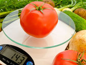 Tomato on the scales — Stock Photo