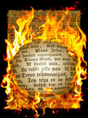 Old text in flame — Stock Photo
