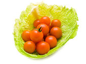 Tomatoes in cabbage — Stock Photo