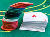 Chips and cards in casino — Stock Photo