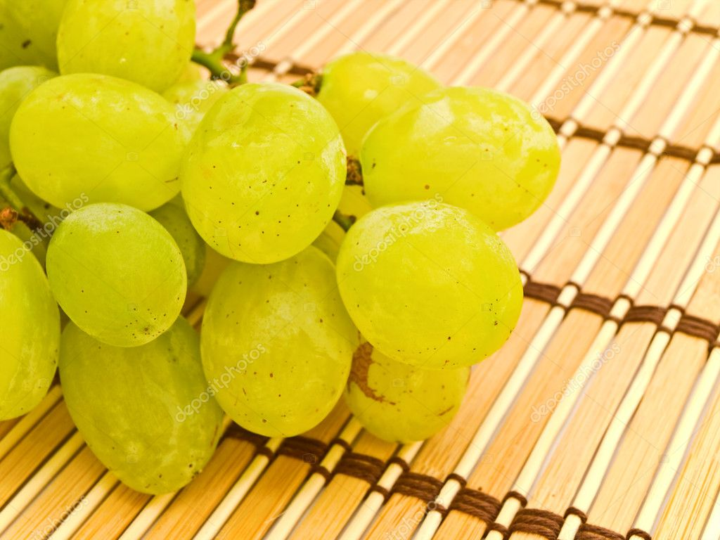 Photo of the background with grape at mat — Stock Photo #1497977