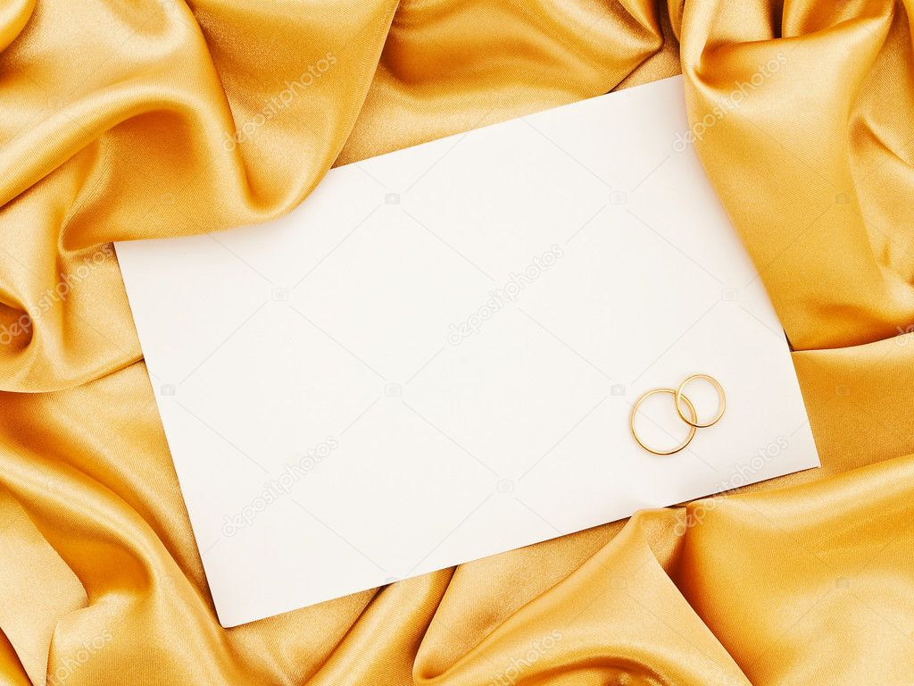 Golden silk textile border round white paper with golden rings  — Foto de Stock   #1498382