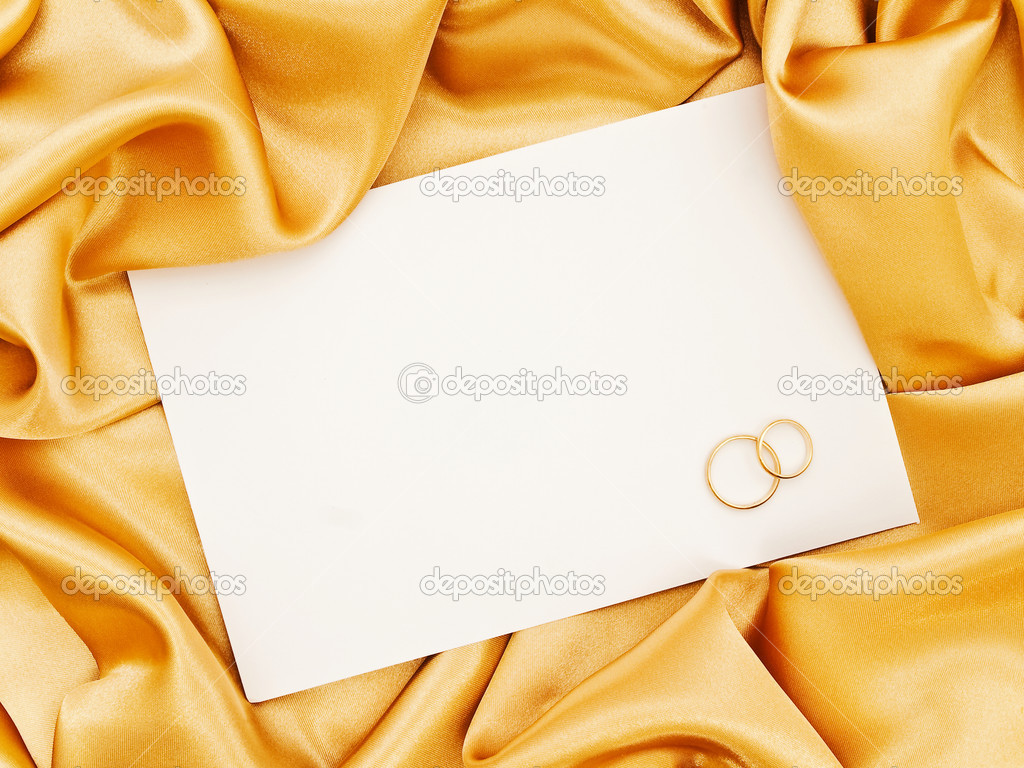 Golden silk textile border round white paper with golden rings   Foto de Stock   #1498382