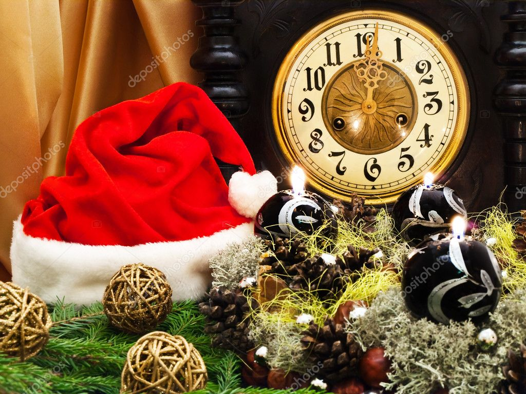 New Year composition with old clock,  Santa hat, fir and handmade garland with candles  Stock Photo #1498600