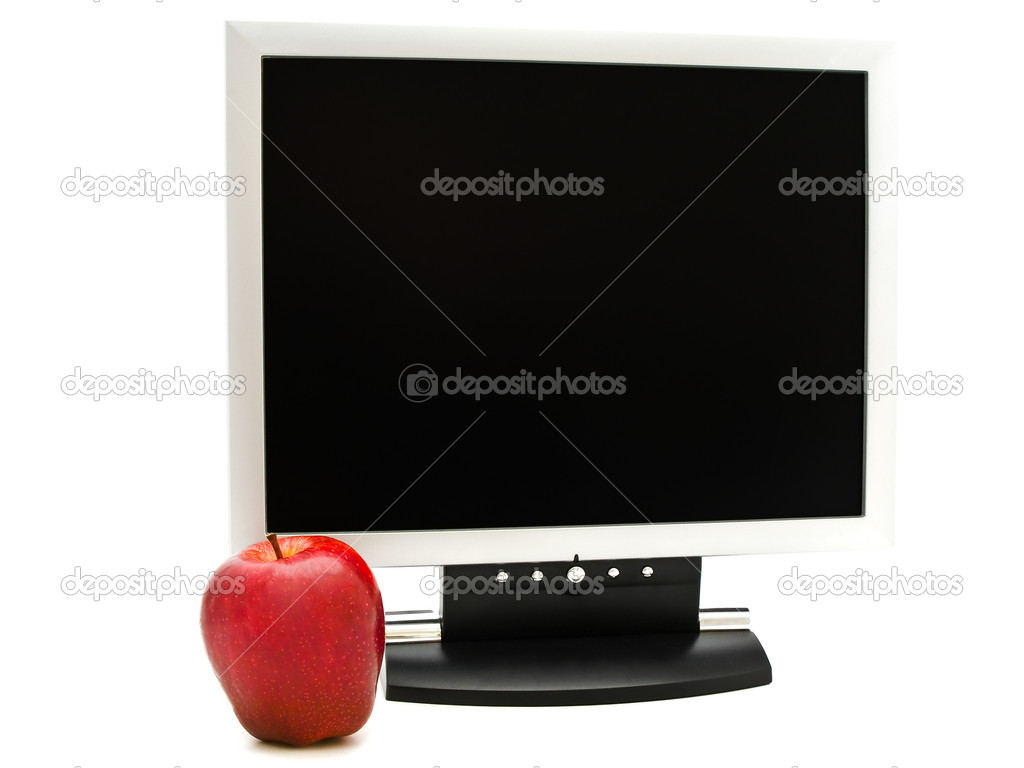 Red apple near the monitor against white background — Stock Photo #1498749
