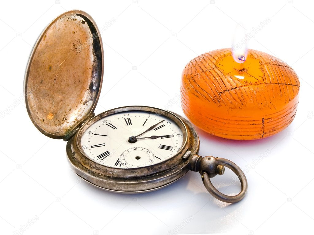 Antique silver pocket watches and a burning candle   Stock Photo #1498782