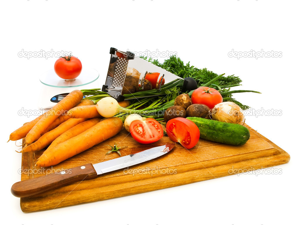 Various vegetables and knife on a kitchen board   Stock Photo #1499151