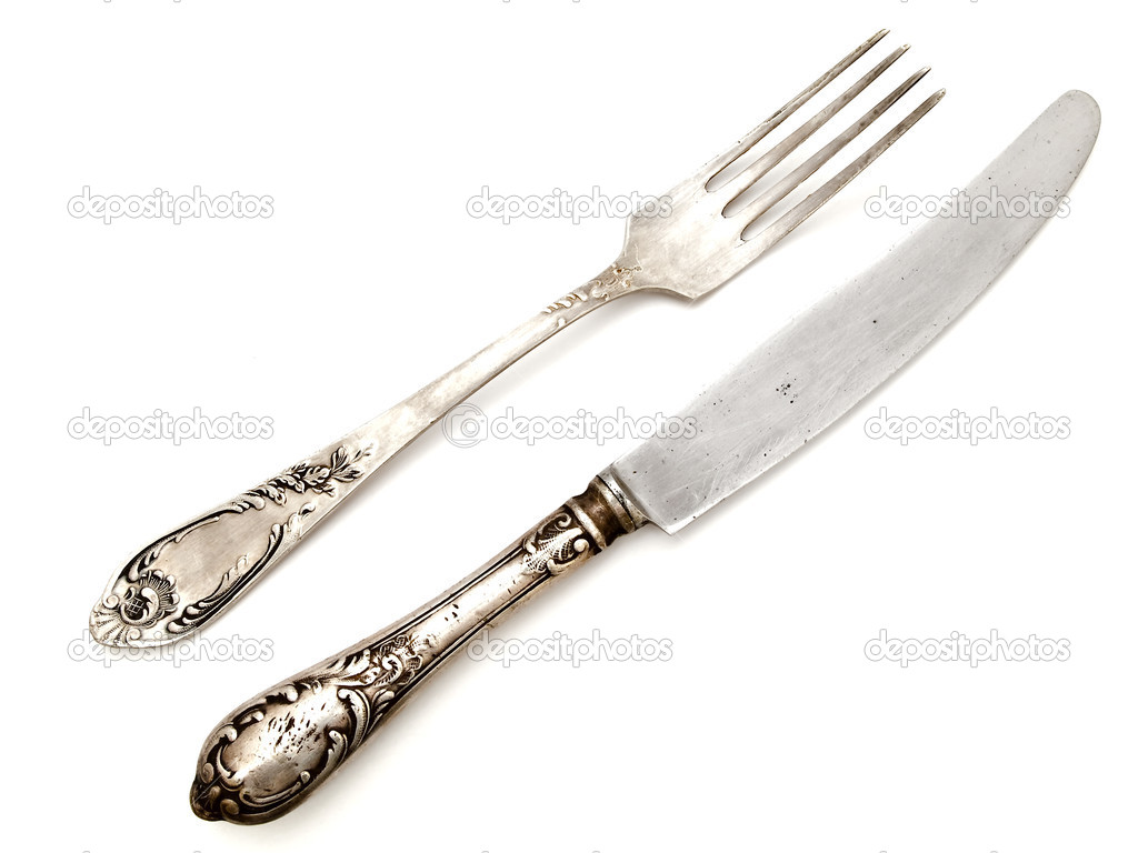 Old fork with knife over the white background — Stock Photo #1499342