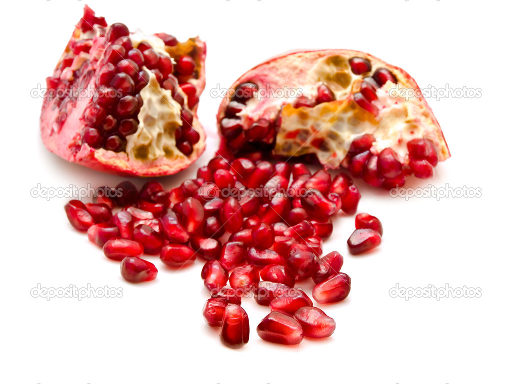 Broken red pomegranate and seeds over the white  Stock Photo #1499367