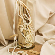 Stock Photo: Clothespins, cord and vase