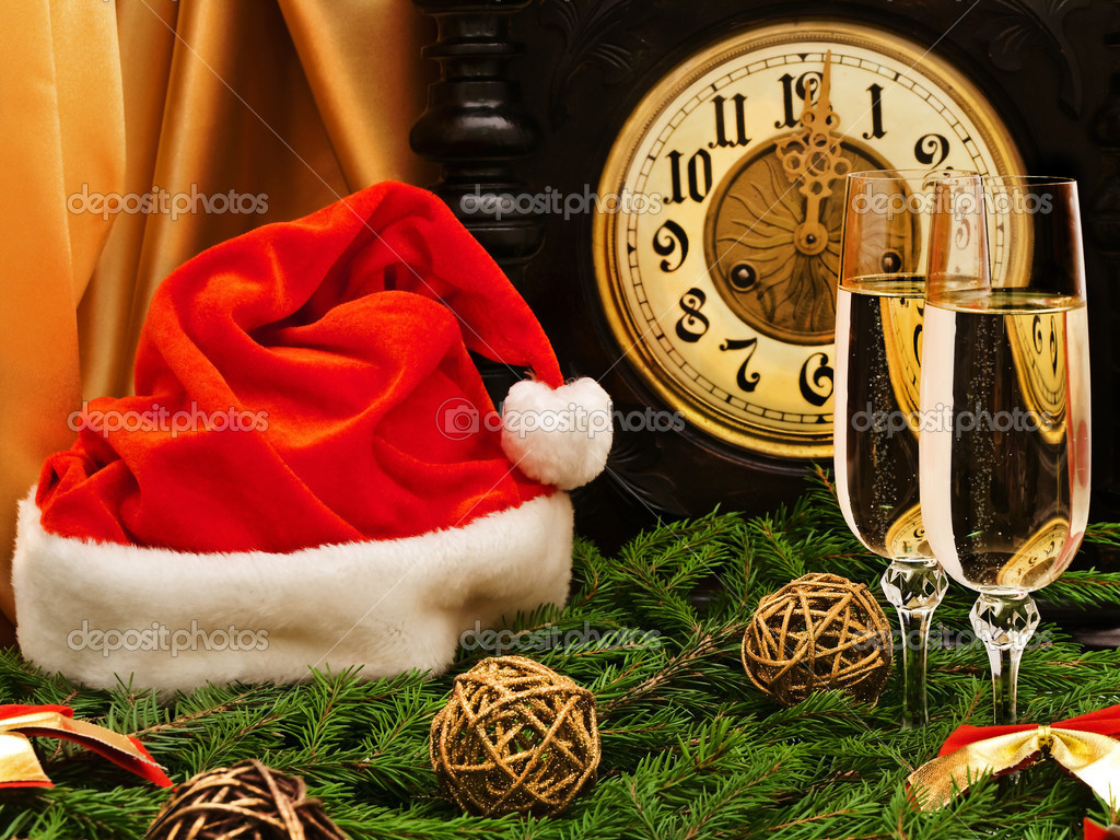 New Year composition with old clock, champagne, Santa hat, fir and decorations — Stock Photo #2287951