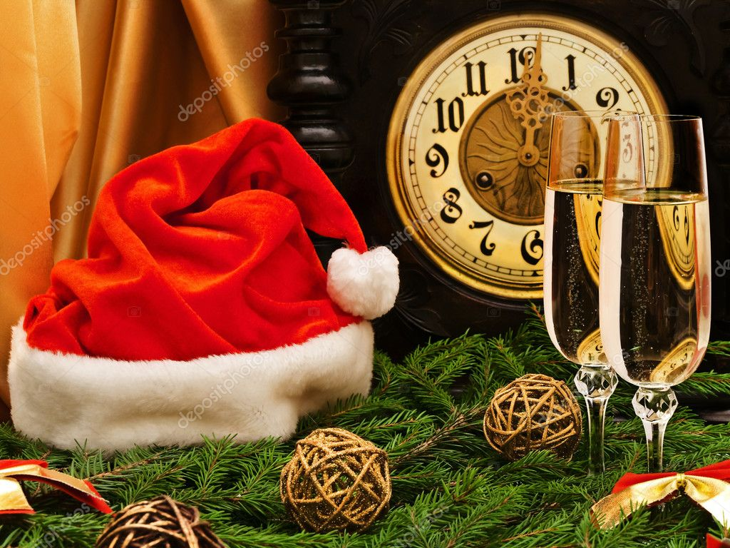 New Year composition with old clock, champagne, Santa hat, fir and decorations   #2287951