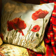 Pillow with poppy - Stock Photo