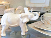 Porcelain elephant and tea service — Stock Photo
