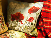 Pillow with poppy — Stock Photo