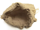 Open beige linen sack with the braids — Zdjęcie stockowe