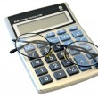Digital calculator and glasses - Foto Stock